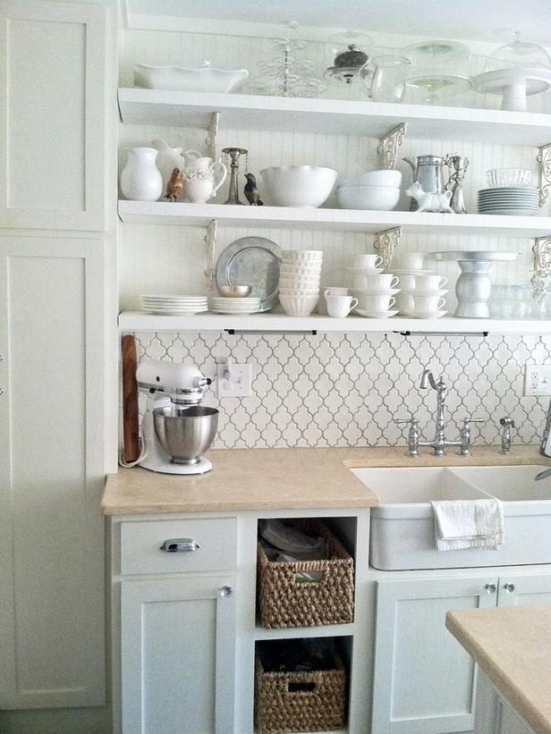 White Cottage Style Kitchen With Open Shelving And A Farmhouse Sink